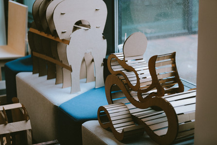 Cardboard mock ups of different seat concepts are skattered about the room.