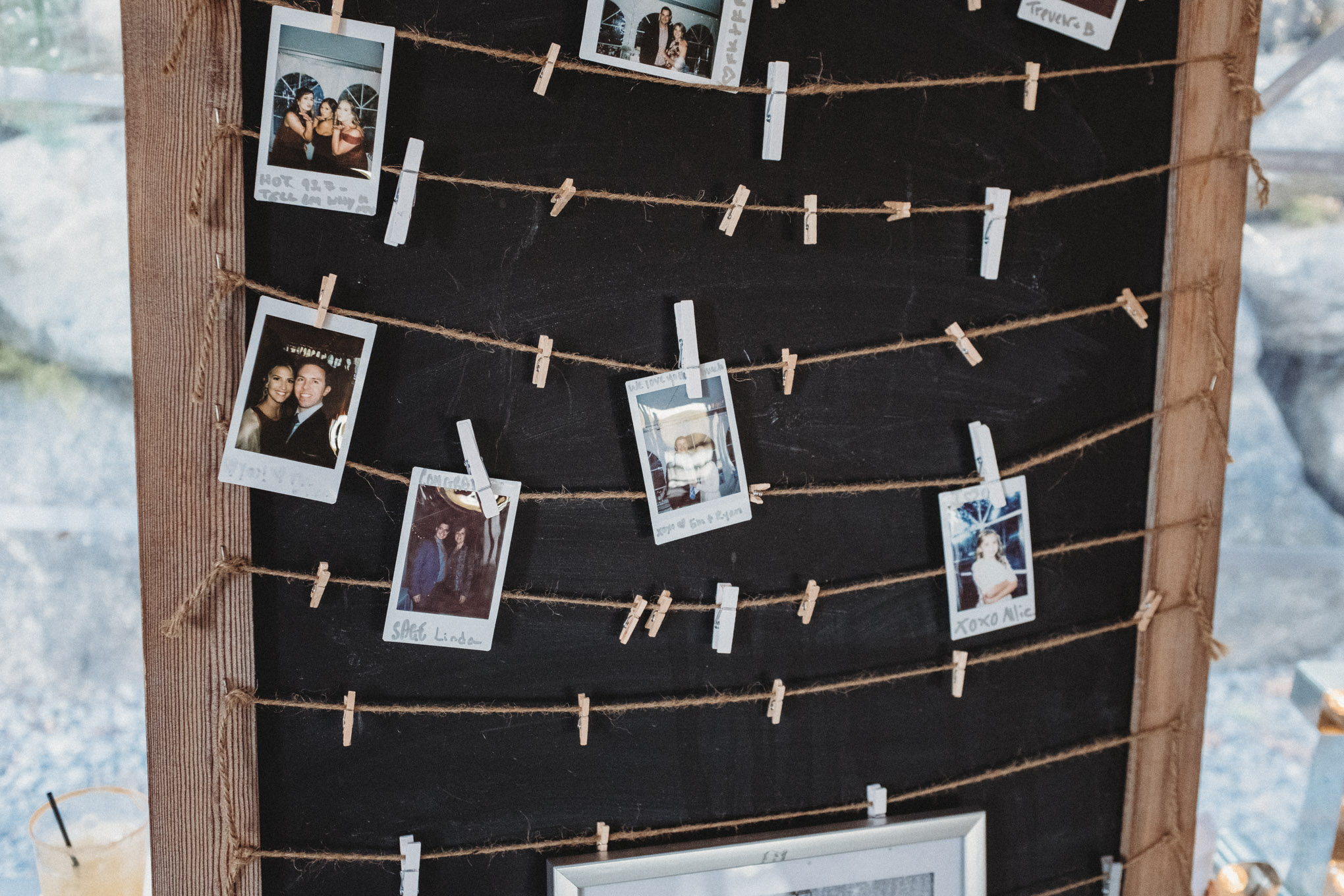 Close up of Polariod pictures that hang from a board.