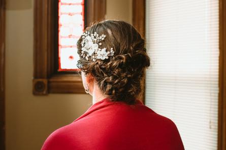 Floral hair piece inside of braided hair.