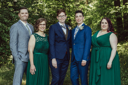 Couple poses with wedding party.