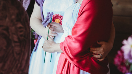 Brides hold hand knit flowers.