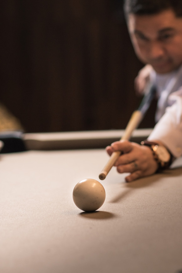 Jimmy playing pool at the lounge in his apartment building.