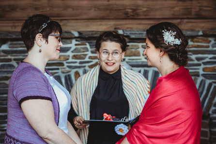 Officiant eagerly sees the couple as they look at each other lovingly.