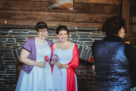 Dani and Sarah hold knit flowars during their ceremony.