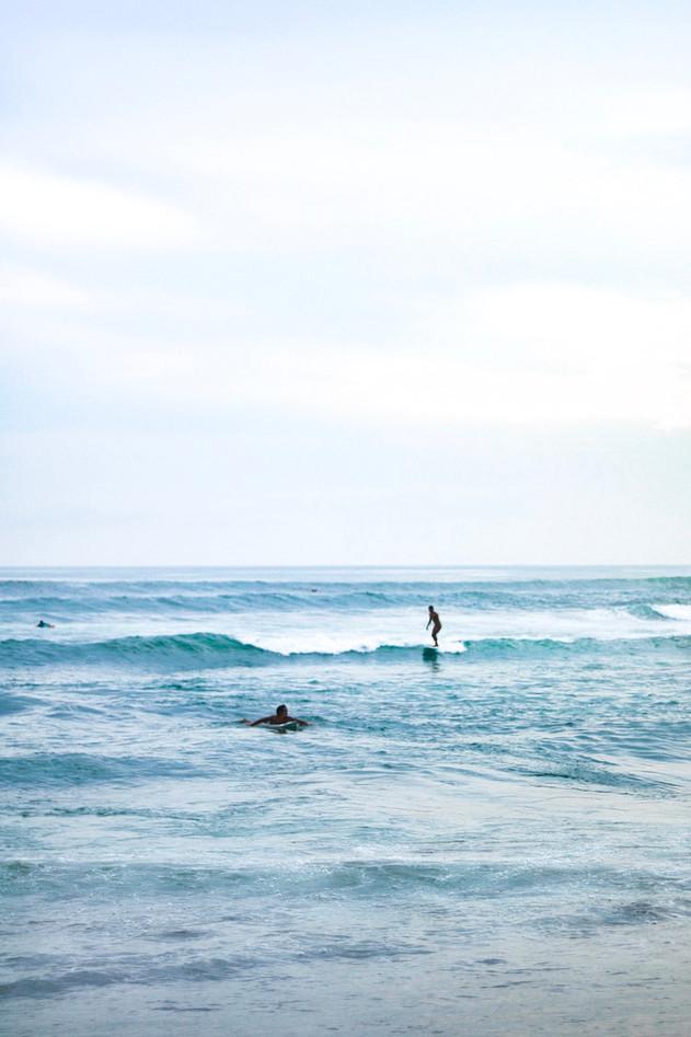 surfers in Bali
