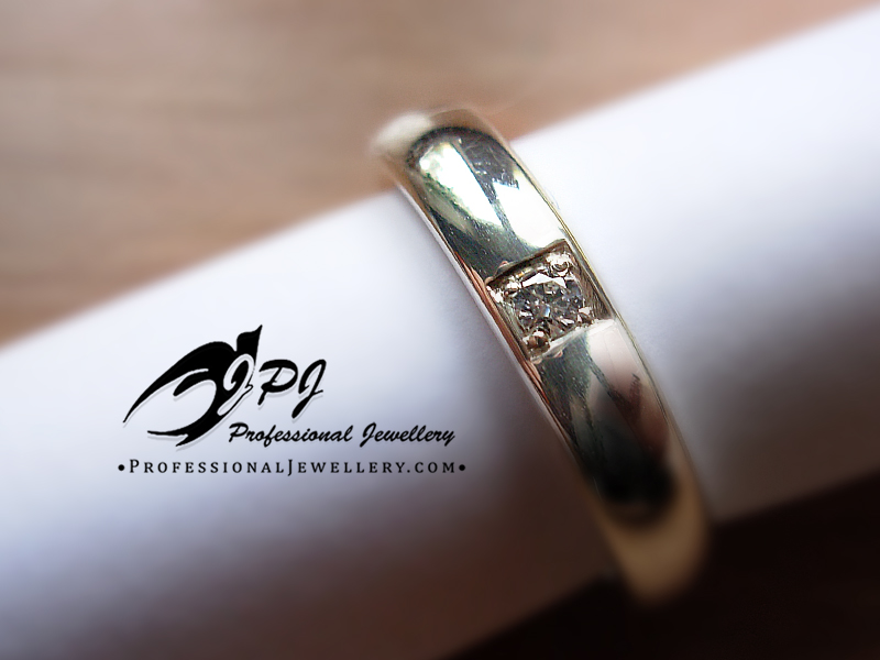 JPJ Professional Jewellery platinum ring with diamond.jpg