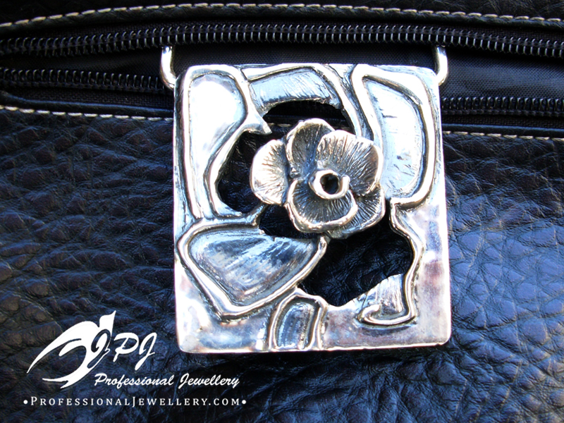 JPJ Professional Jewellery sterling silver belt buckle with floral motif.jpg