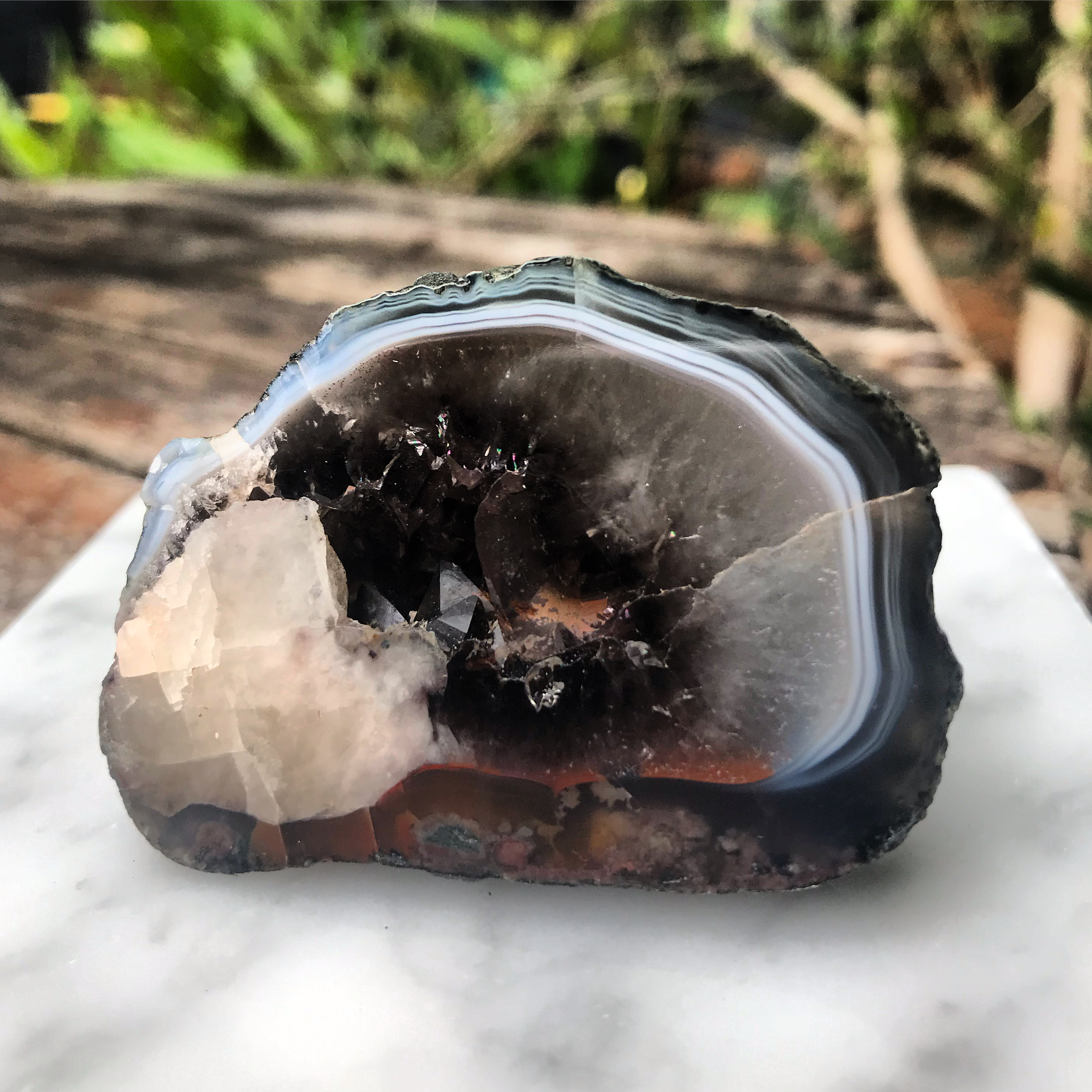 British Geode with calcite, smoky quartz and iron inclusions