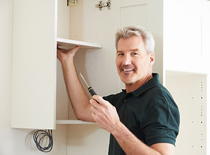 Carpenter Installing Luxury Fitted Kitch