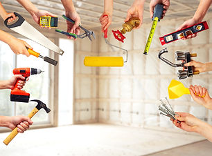 Hands with construction tools. House Ren