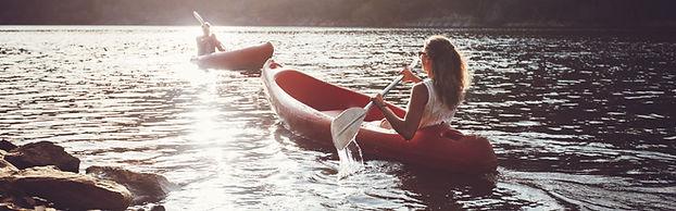 Kayakers Rowing On A Lake.jpg