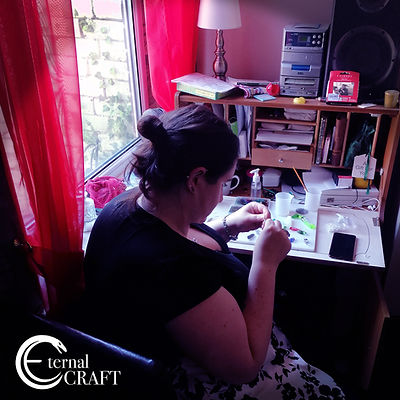 Emma Smith sat at her desk working with resin.