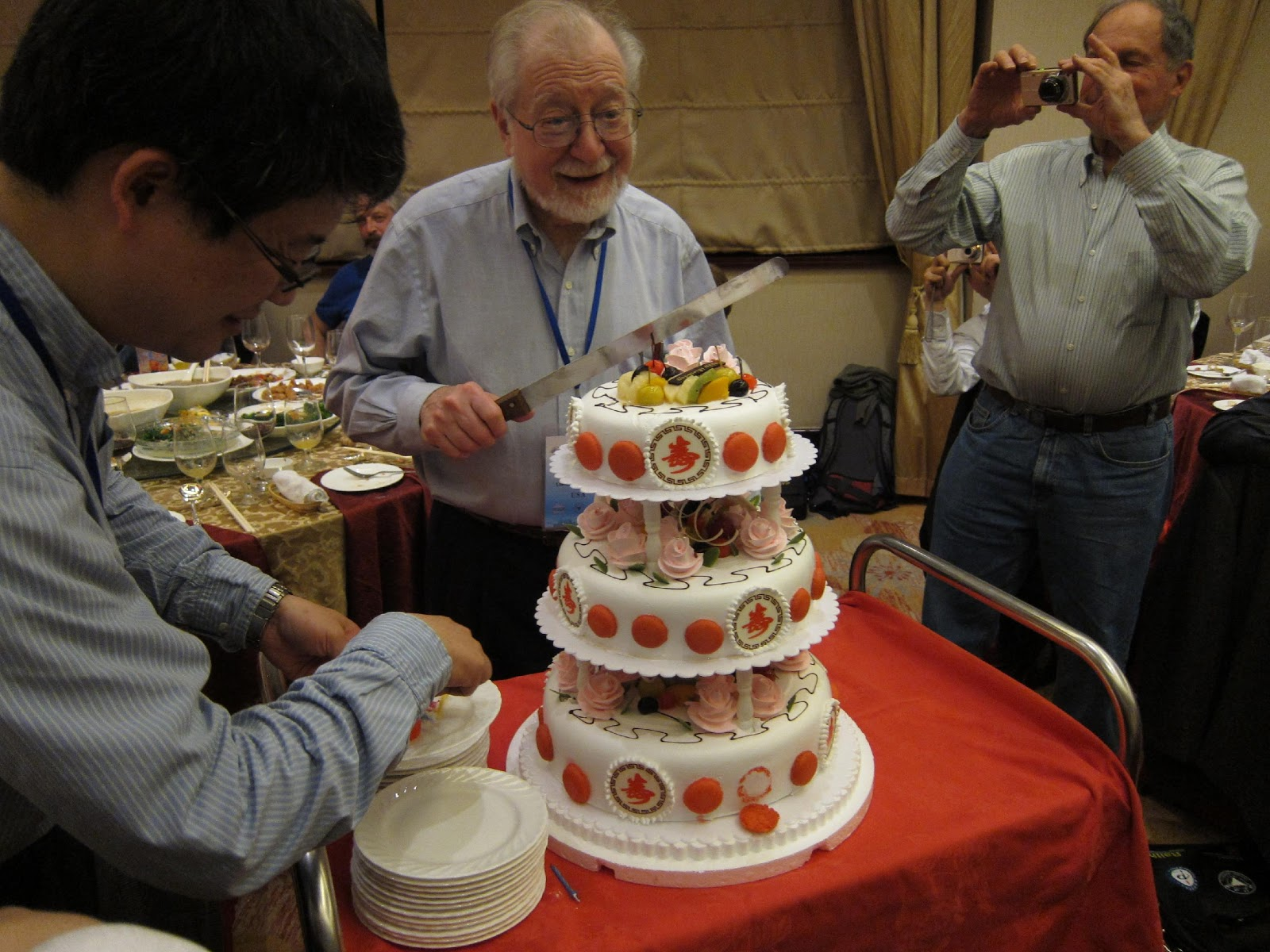 Steve Berry, cutting the cake on the occasion of his 80th birthday, in Hangzhou, China, April 2011.