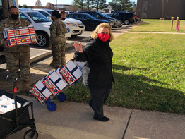 LCLA donates holiday bags to quarantined Airmen