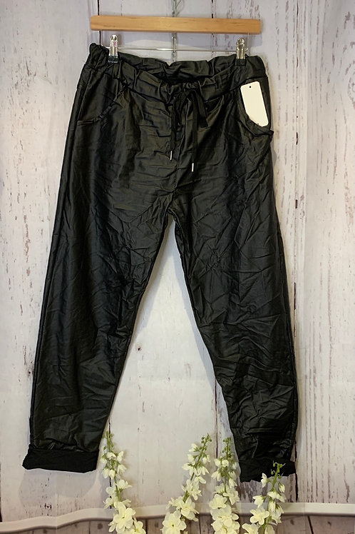 Leather look. plus size magic trousers