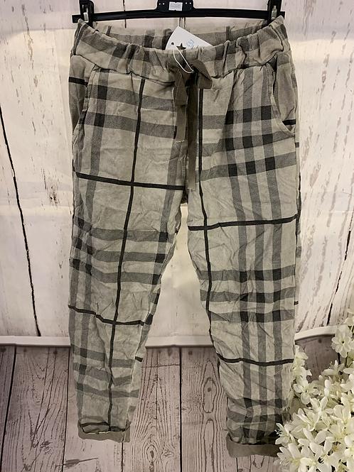 Beige checkered magic trousers