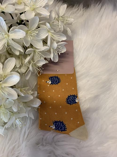 Mustard dot hedgehog socks