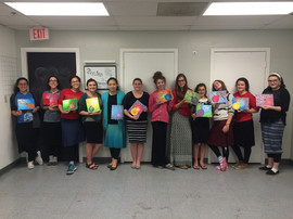 Counselors Showing off their Paintings