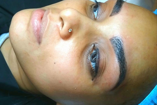 customer getting eyebrow treatment