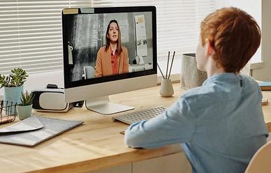 virtual-school-kid-watching-zoom-meeting