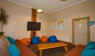 cosy warm lounge, with book library and board games.