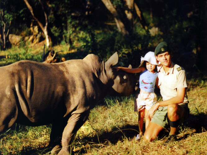 Colin with his daughter and their hand-reared rhino