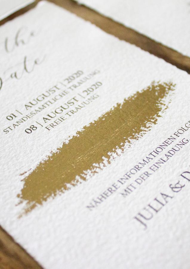 Pinselstrich gold