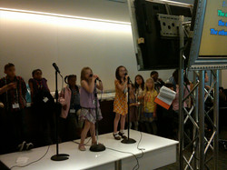 Kids Singing at an Event
