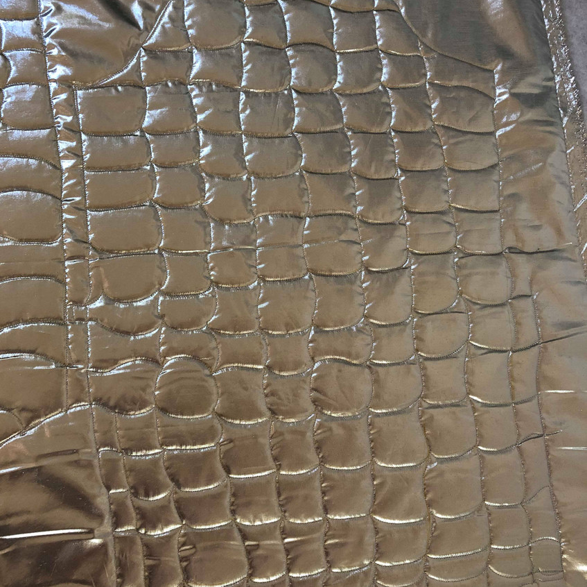 Silver Lame being quilted