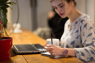 Girl Working in a Cafe