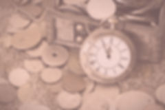 Pocket watch with money chest on sand Image by annca from Pixabay