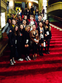 Performers on the red carpet at Academy