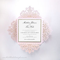 Folded laser-cut invitations