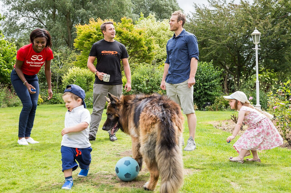 Fun in the garden with Craig, his two children and dogs