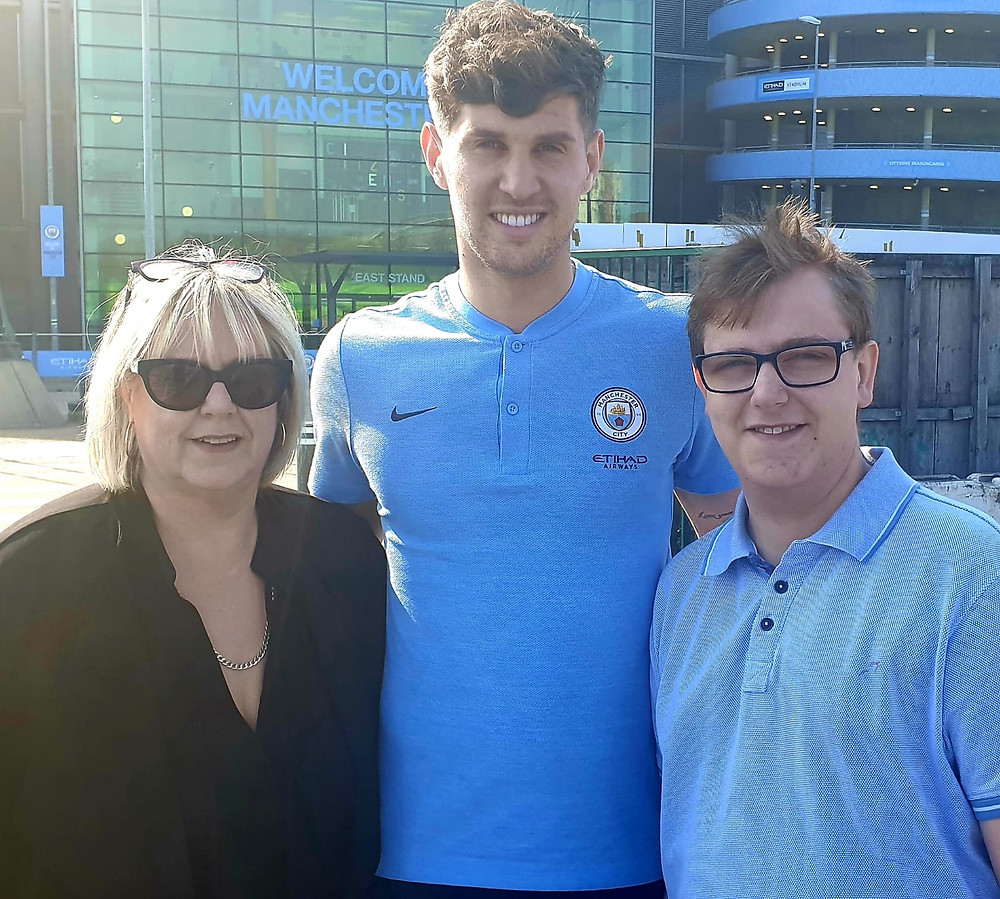 John Stones posing for a picture with Connor and Maria