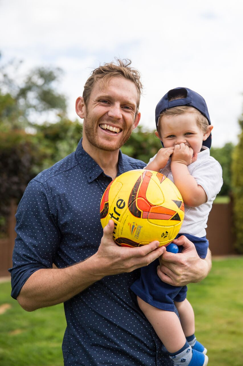 Craig with son Jude and his favourite outdoor toy - a football!