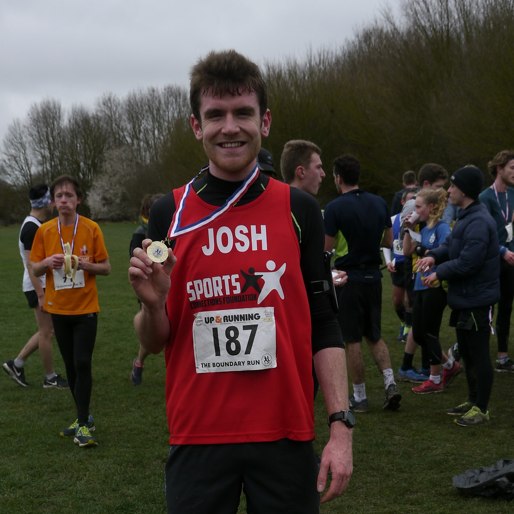Josh holding up his medal after an incredible race!