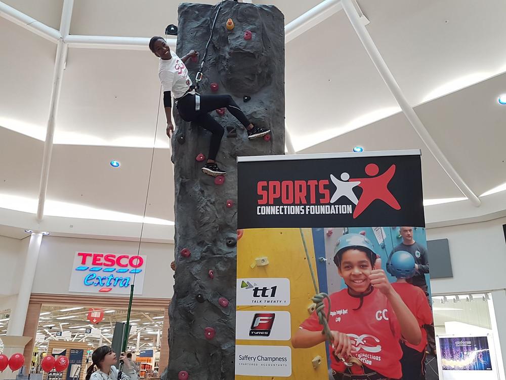 SCF's Nicole Moore climbing the wall!