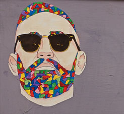 Abstract drawing of a man's face with multi-colored hair and beard
