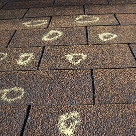 hail-damage-on-a-residential-roof-450x45