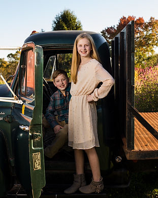 Camp Hill PA Family Photographer Brother and Sister in Truck