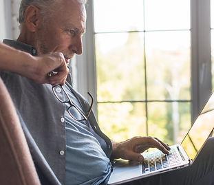 senior man laptop glasses.jpg