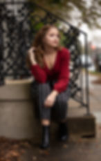 teen sitting on stairs in red top.jpg