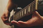man-playing-on-guitar-P8EJSKJ.jpeg