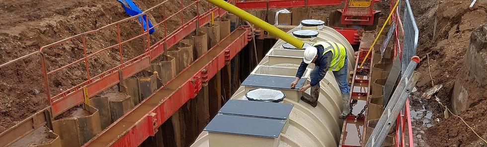 Sewage treatment install on site.jpg