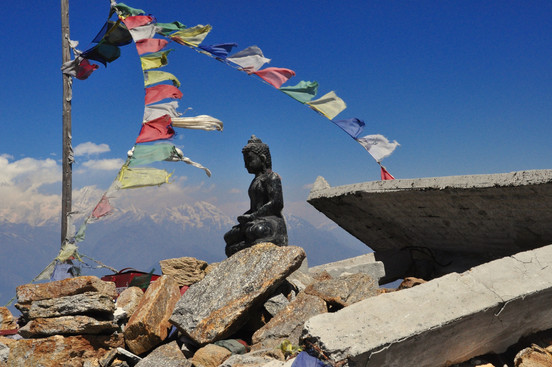 A statue of Buddha sits atop the rubble from the 2015 earthquake.
