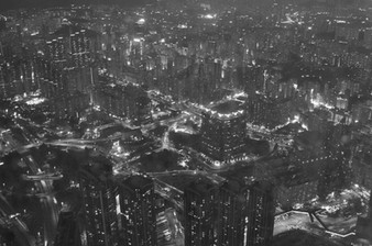 "Hong Kong from the Ritz Carlton. The hotel occupies the top floors of Hong Kong's tallest building, the International Commerce Centre, on Kowloon Island. Hong Kong's extravagance is well known and I always feel the best example of this is the daily 6pm ""Symphony of Lights"". The light show is a coordinated spectacle of 40 Hong Kong buildings, the skyscrapers changing colours and flashing at varying speeds. From the Peak on Hong Kong Island, the sight is extraordinary."