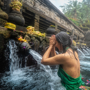 woman-standing-in-front-of-flowing-water