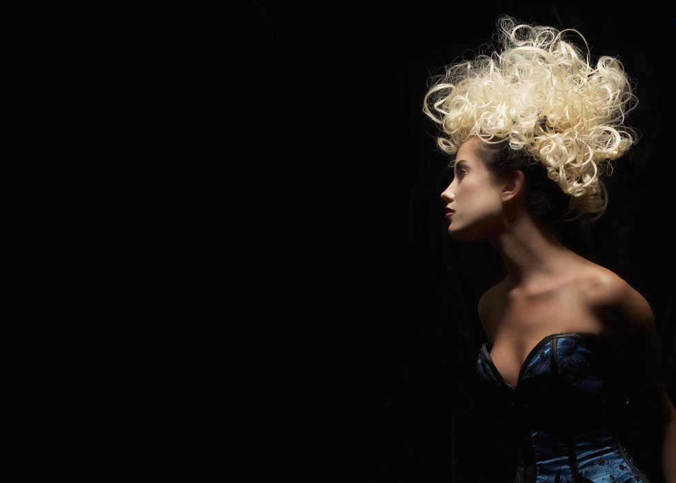 Blonde curly haired model with avant garde updo