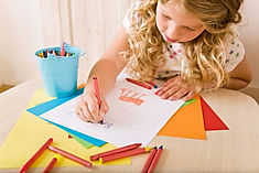 An image of a child drawing a visual cue to support spelling